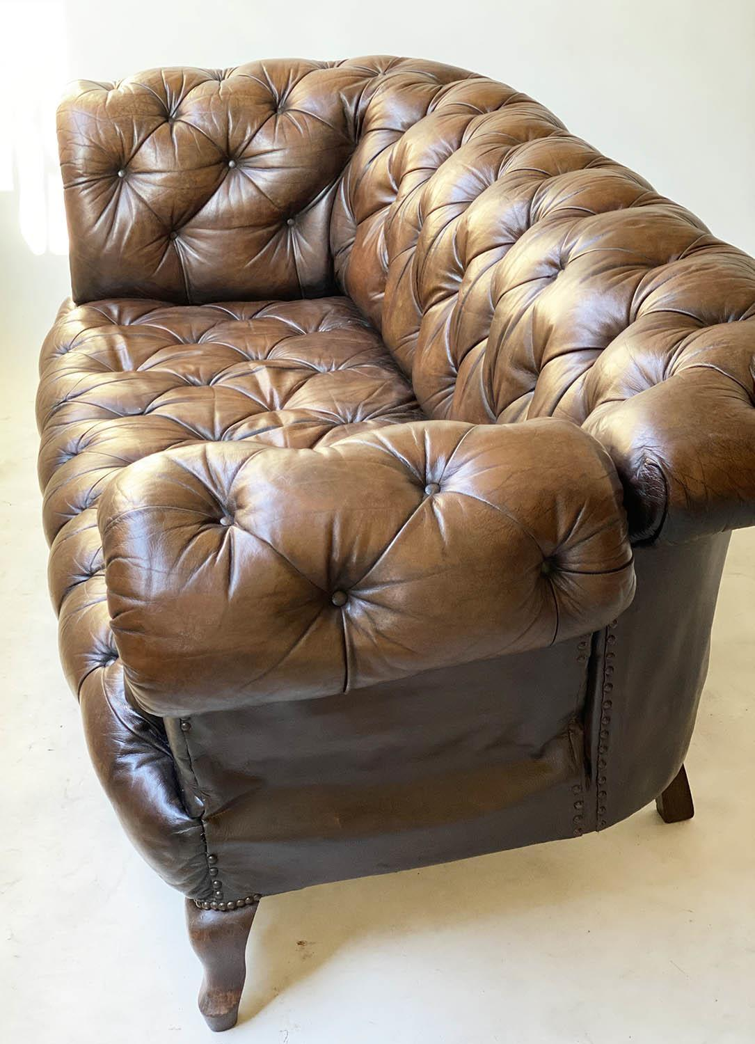 CHESTERFIELD SOFA, early 20th century Edwardian aged and faded brown leather with horsehair buttoned - Image 9 of 10