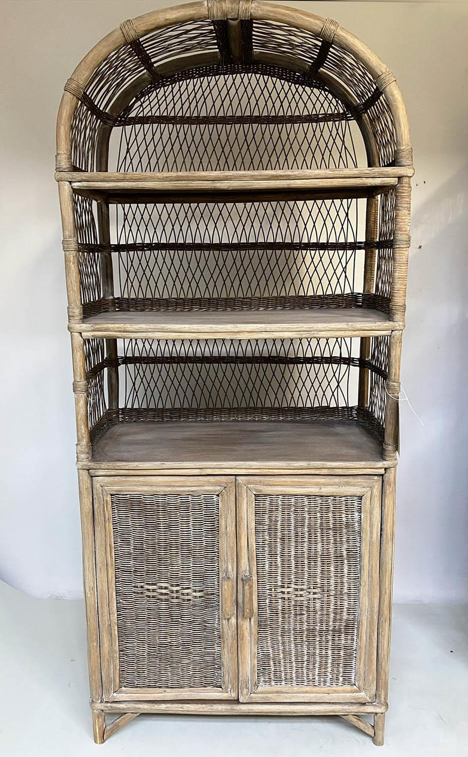 CANE BOOKCASE, rattan bamboo and cane bound with wicker panels each arched with shelves and