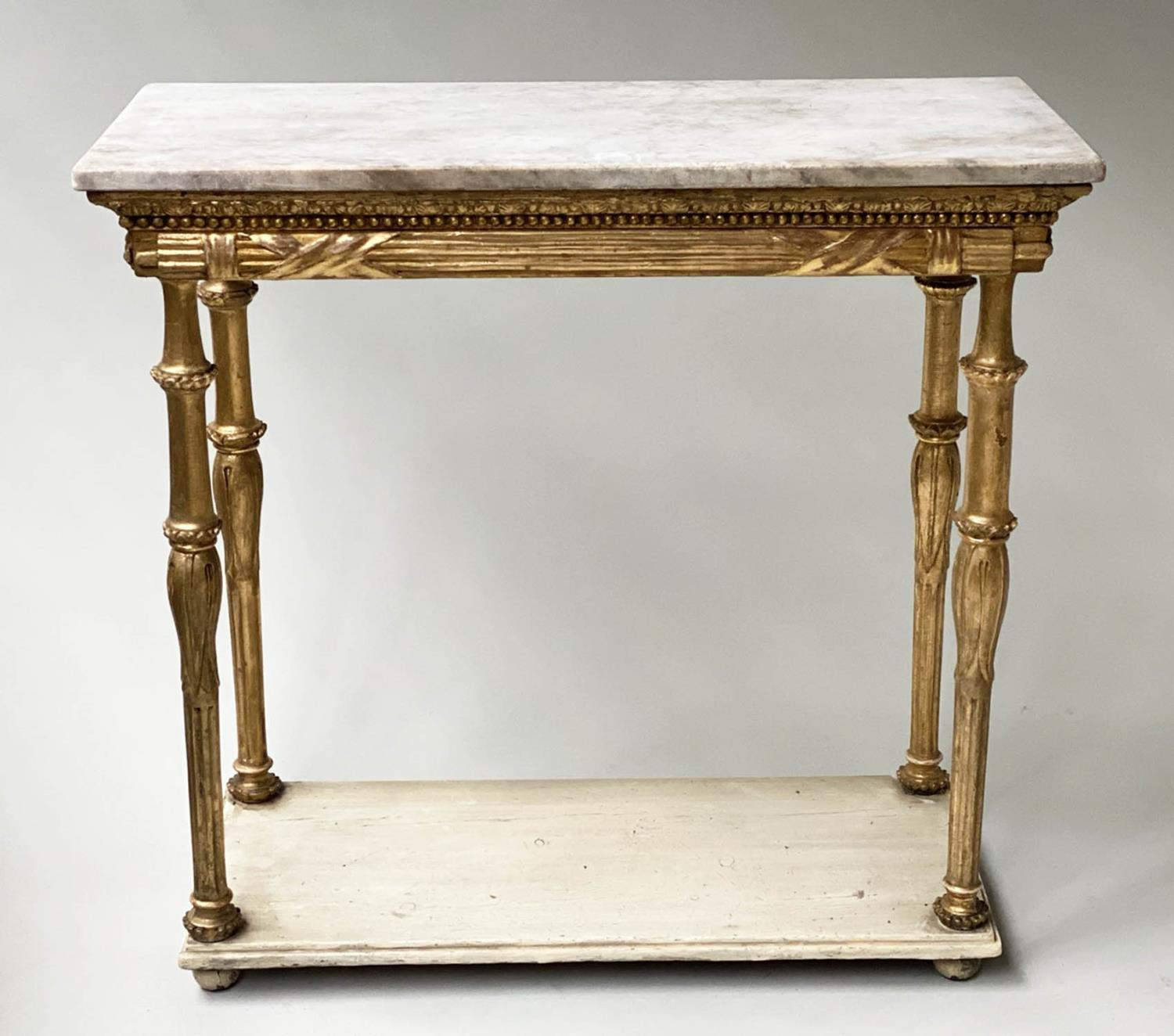 CONSOLE TABLE, early 19th century Italian giltwood with rectangular marble top above lappet and