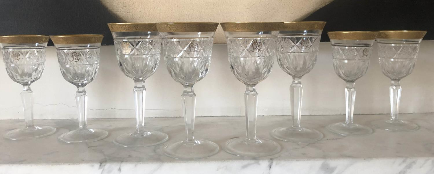 GLASSWARE, eight cut crystal patterned gilded tops, two sets of four, 18cm H and 16cm H. (8)