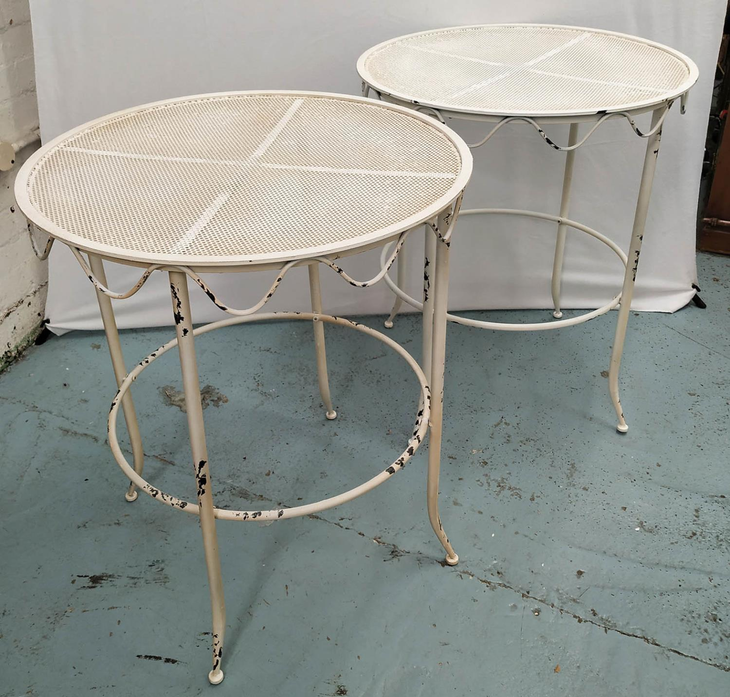 GARDEN SIDE TABLES, a pair, 1960's French style, aged white painted finish, 73cm H x 62cm Diam. (2)