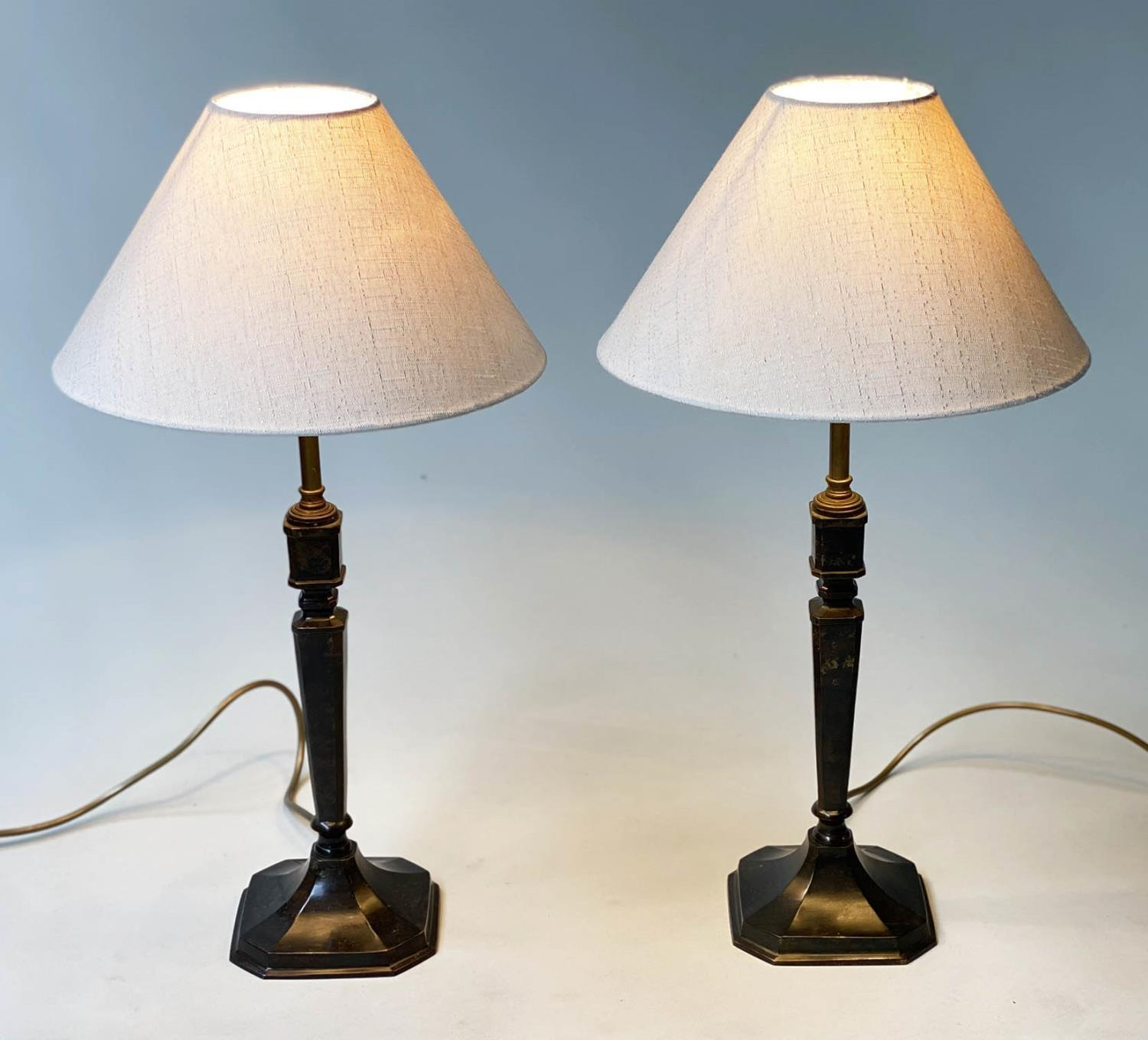 TABLE LAMPS, a pair, patinated bronze, each with faceted square form columns and white silk 'coolie'