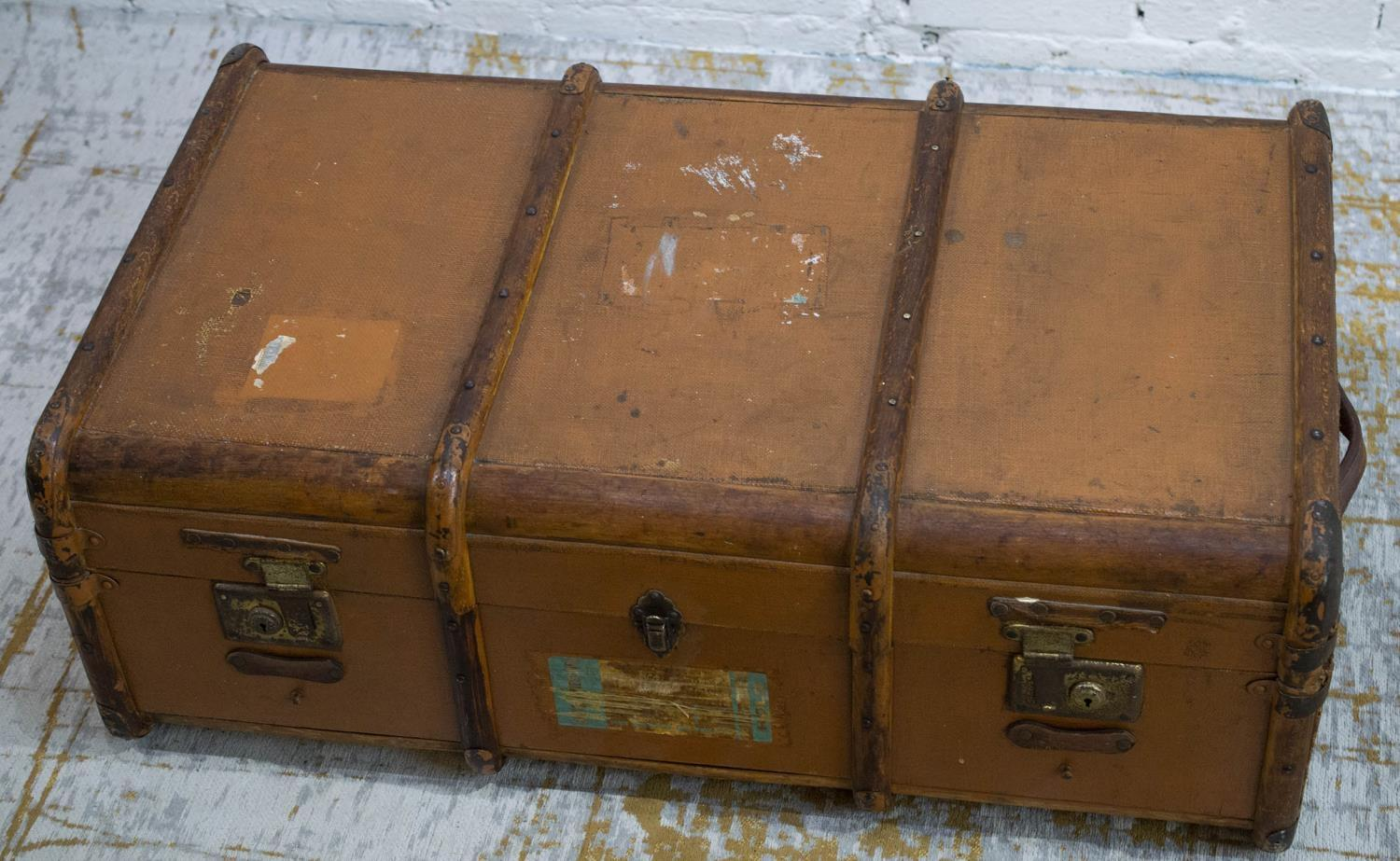 TRUNK, early 20th century canvas and bentwood with brass studs and mounts, bears original luggage