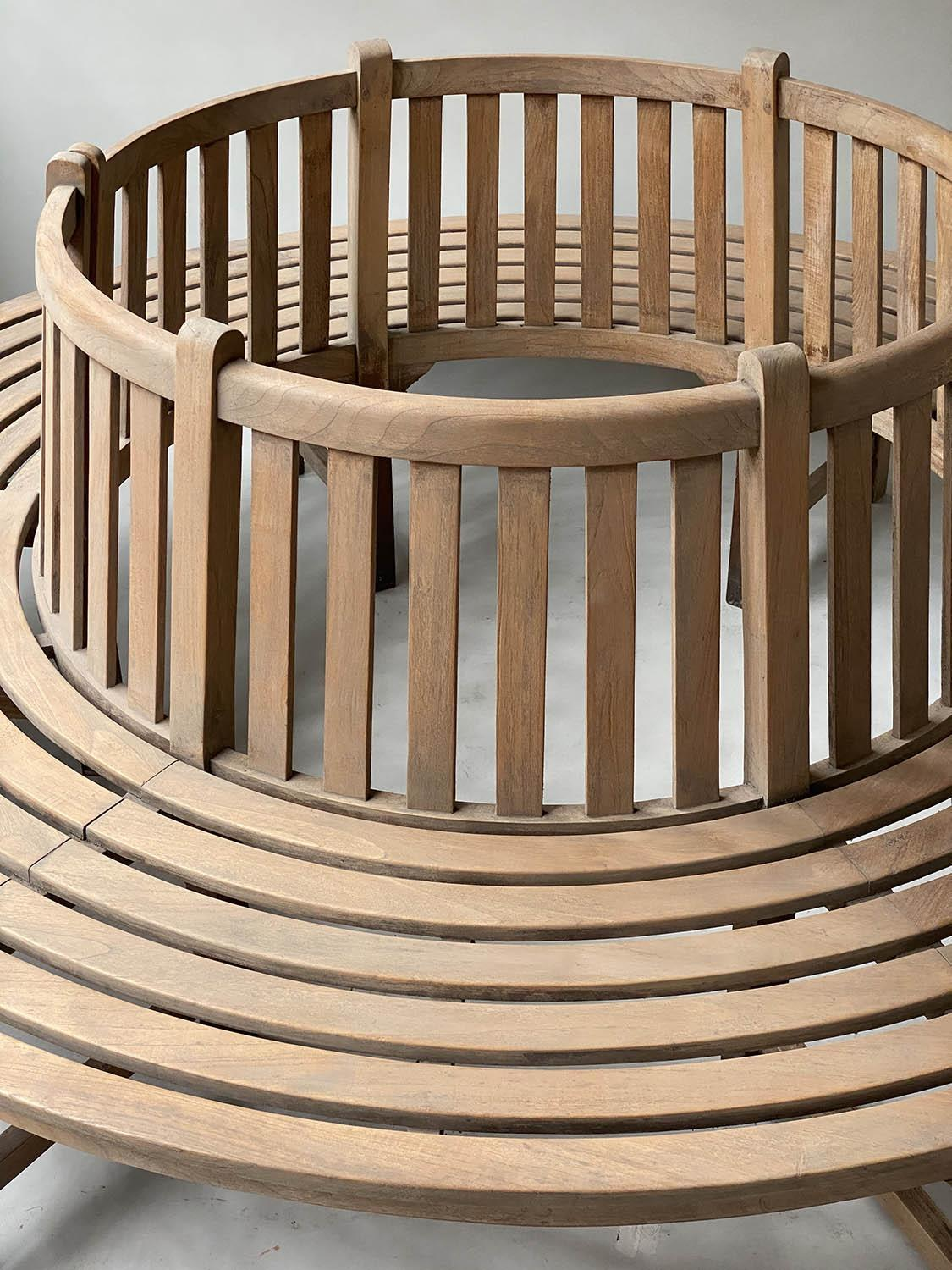 TREE BENCH, weathered teak and slatted in two sections of concentric slats and raised back rest, - Image 4 of 7