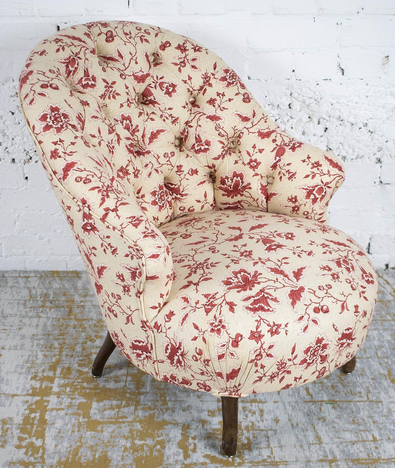BERGERE, Napoleon III mahogany in cream and red foliate patterned upholstery, 75cm H x 61cm x 73cm.