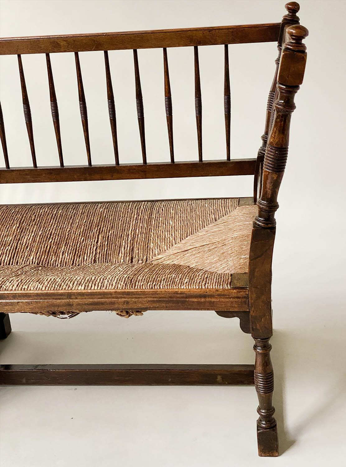 HALL BENCH, 19th century English oak with spindle back rush seat and stretchered turned supports, - Image 2 of 9