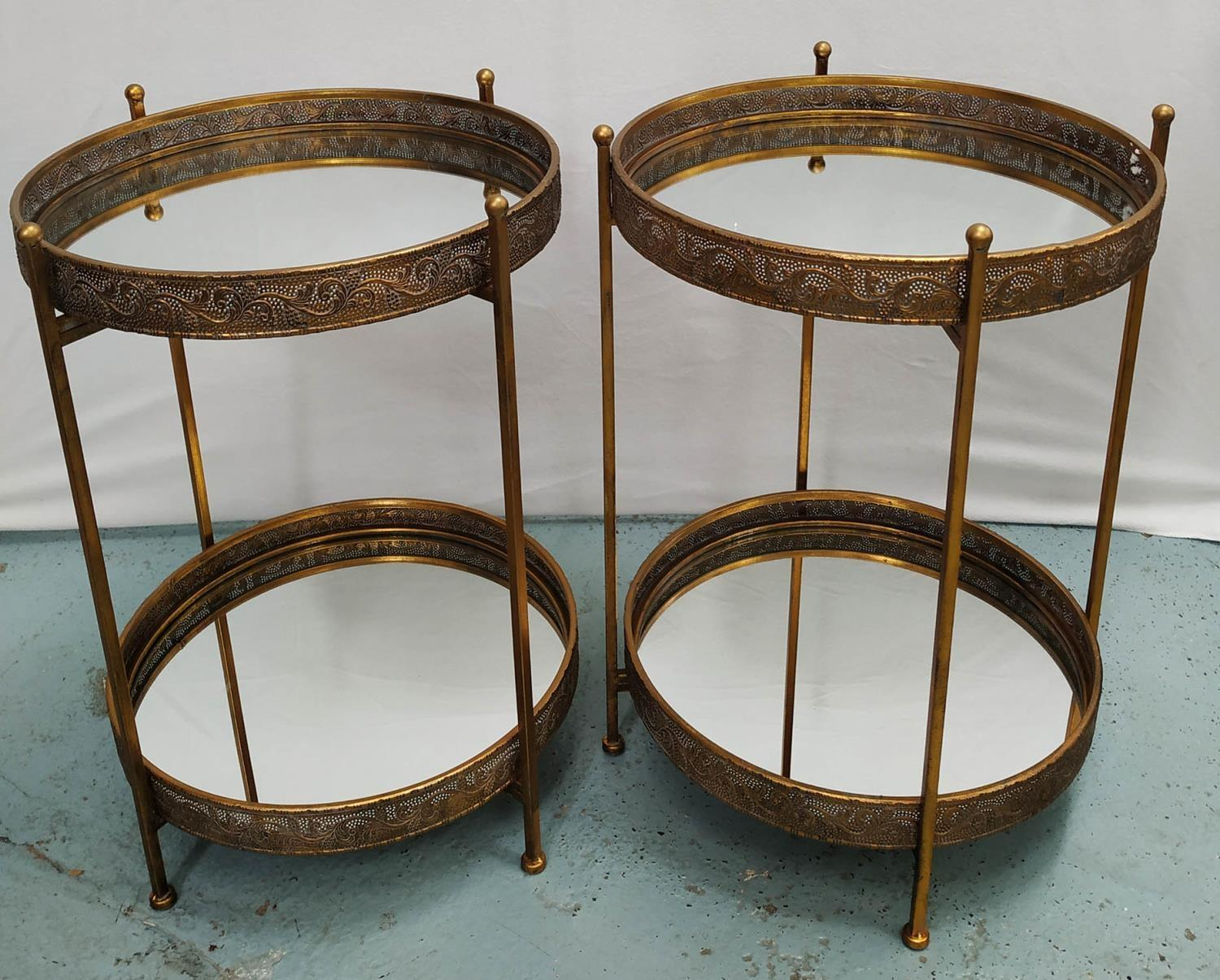 SIDE TABLES, a pair, gilt metal with two mirrored tiers, 63cm H x 48cm Diam. (2)