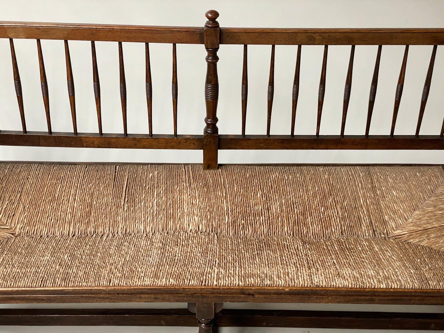 HALL BENCH, 19th century English oak with spindle back rush seat and stretchered turned supports, - Image 3 of 9