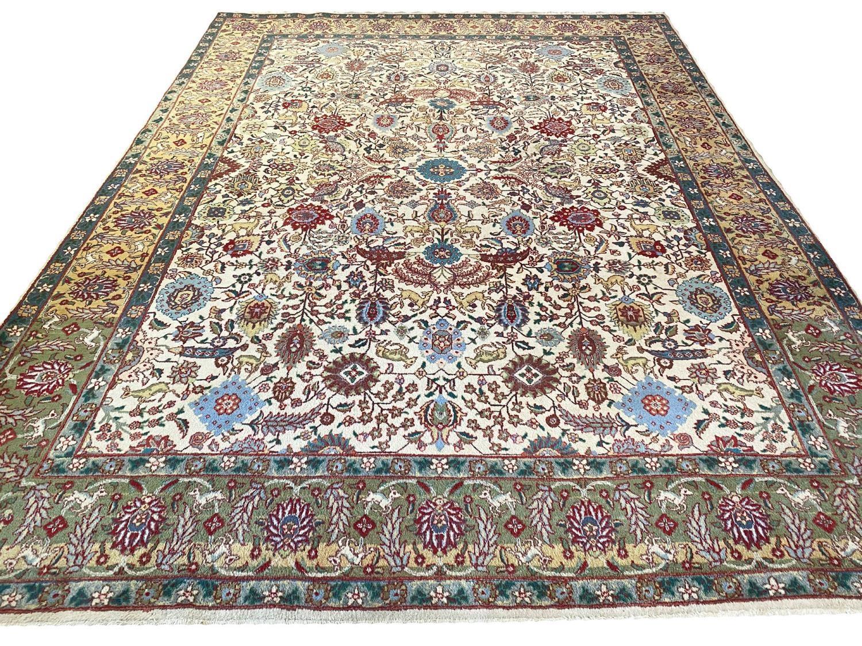 FINE PERSIAN TABRIZ CARPET, 387cm x 288cm, all over palmette and vine design with deer motifs within