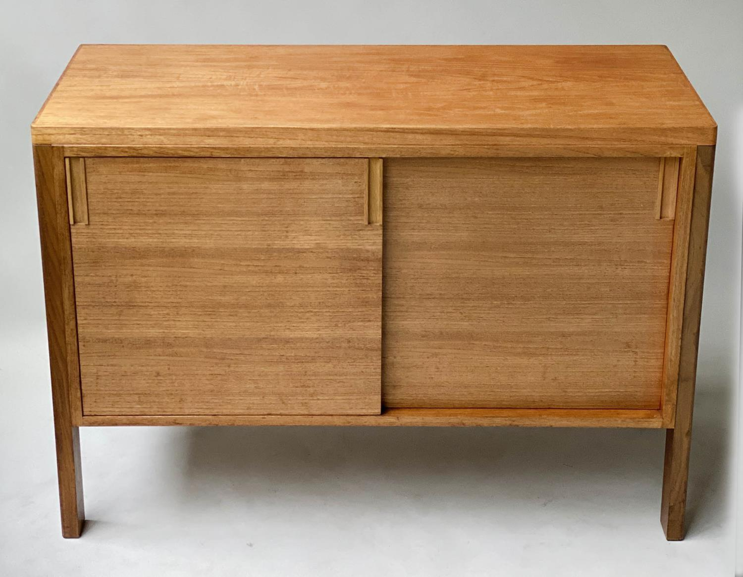 GORDON RUSSELL SIDEBOARD, 1960's walnut with two sliding doors enclosing shelves stamped Gordon