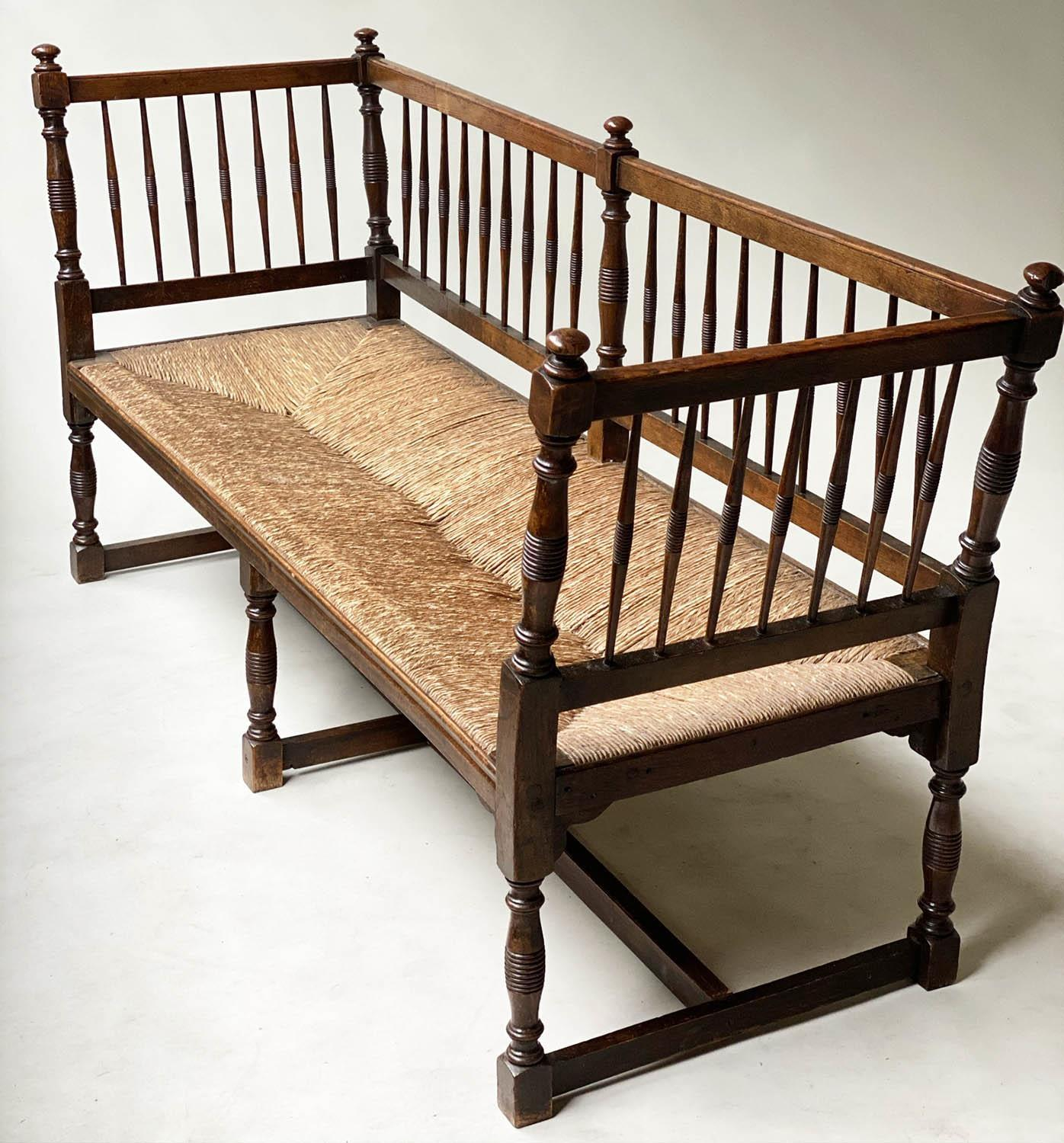 HALL BENCH, 19th century English oak with spindle back rush seat and stretchered turned supports, - Image 9 of 9