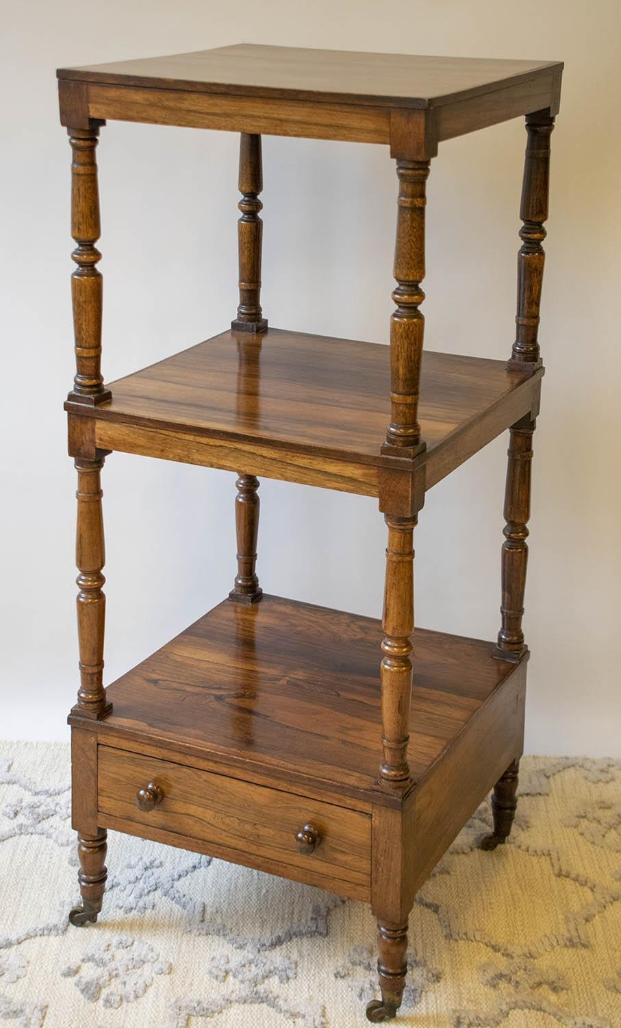 WHATNOT, George IV rosewood, circa 1820, of three tiers with single drawer on brass castors (upper