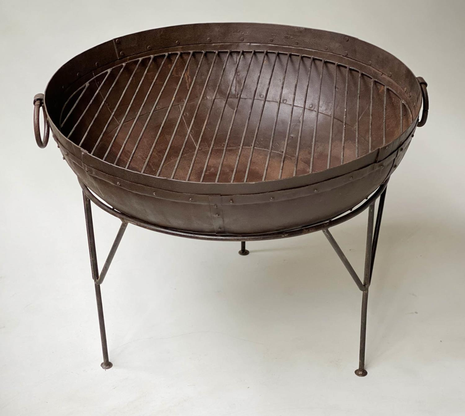 FIREPIT, riveted bowl form with grill and wrought iron stand, 84cm x 65cm H.