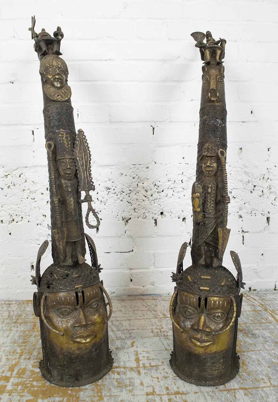 BENIN OBA BRONZE THRONE HEADS, a pair, 105cm H. (2)