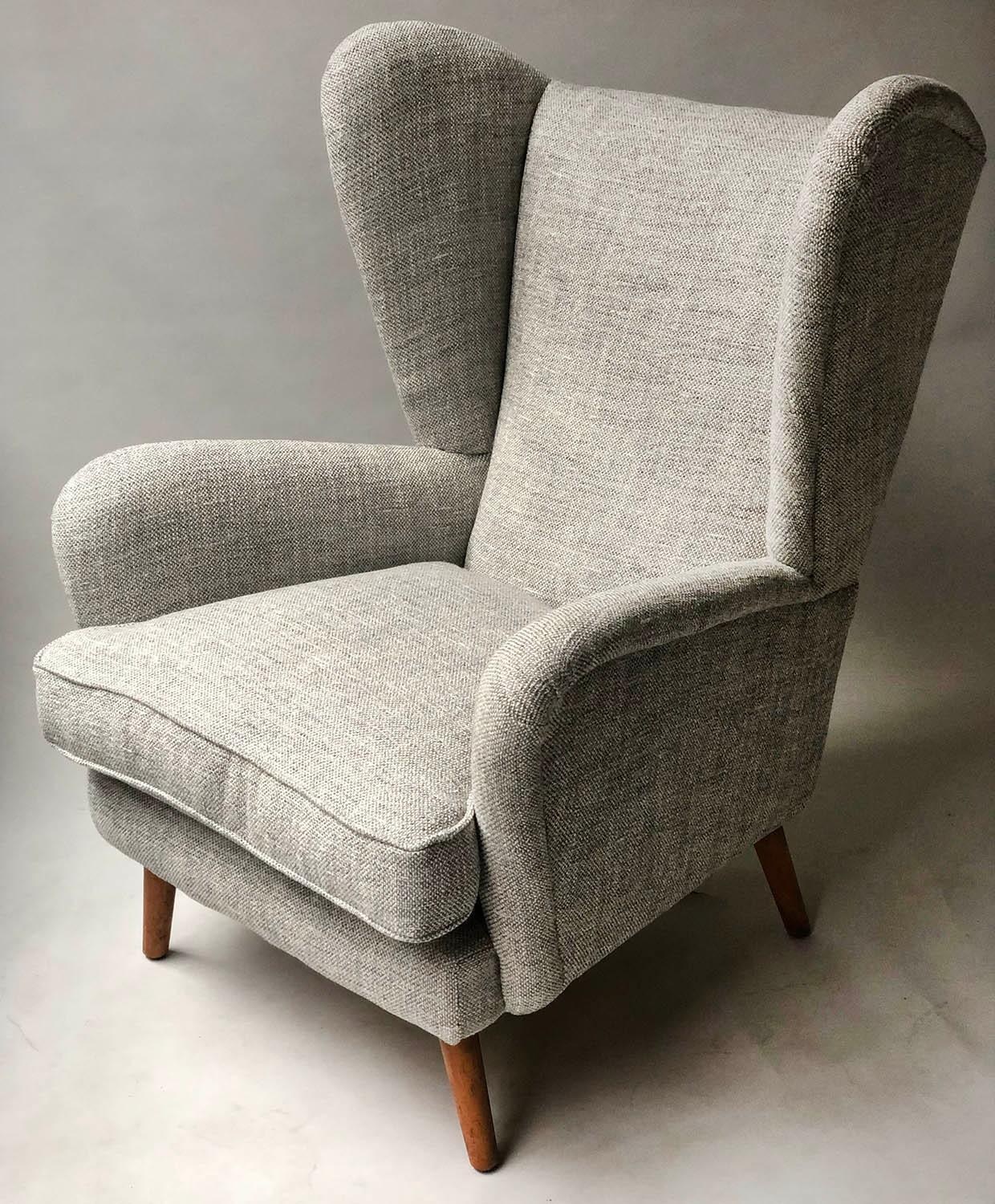 HOWARD KEITH ARMCHAIR, 1950's lounge chair newly upholstered in oatmeal soft tweed with splay