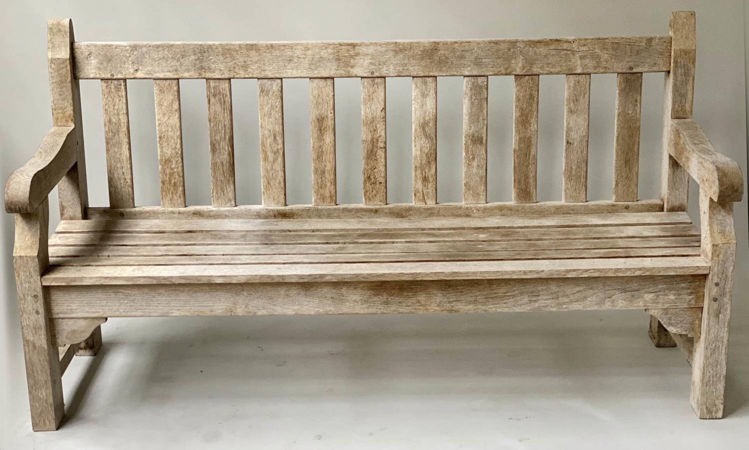 ENGLISH GARDEN BENCH, weathered English oak of substantial and slatted construction, 168cm W.