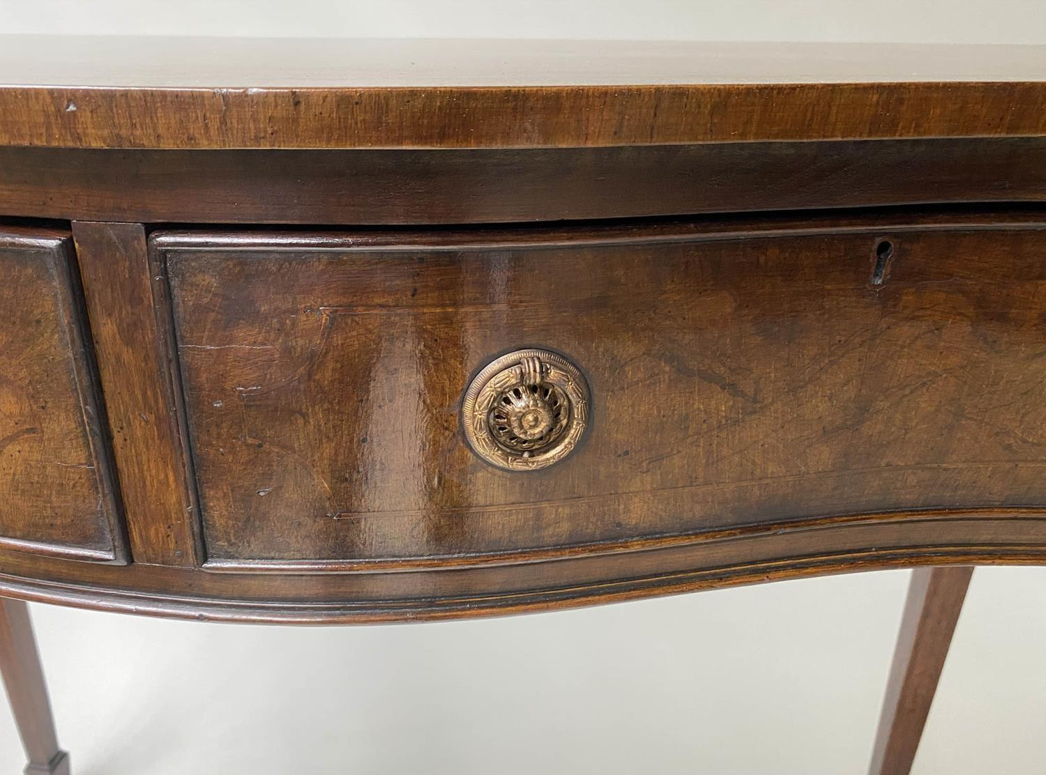 HALL TABLE, George III style figured mahogany and brass inlaid of serpentine outline with two frieze - Image 7 of 9