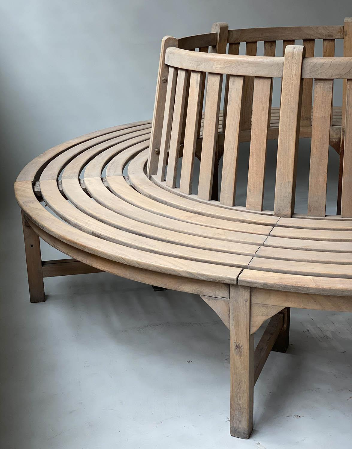 TREE BENCH, weathered teak and slatted in two sections of concentric slats and raised back rest, - Image 3 of 7
