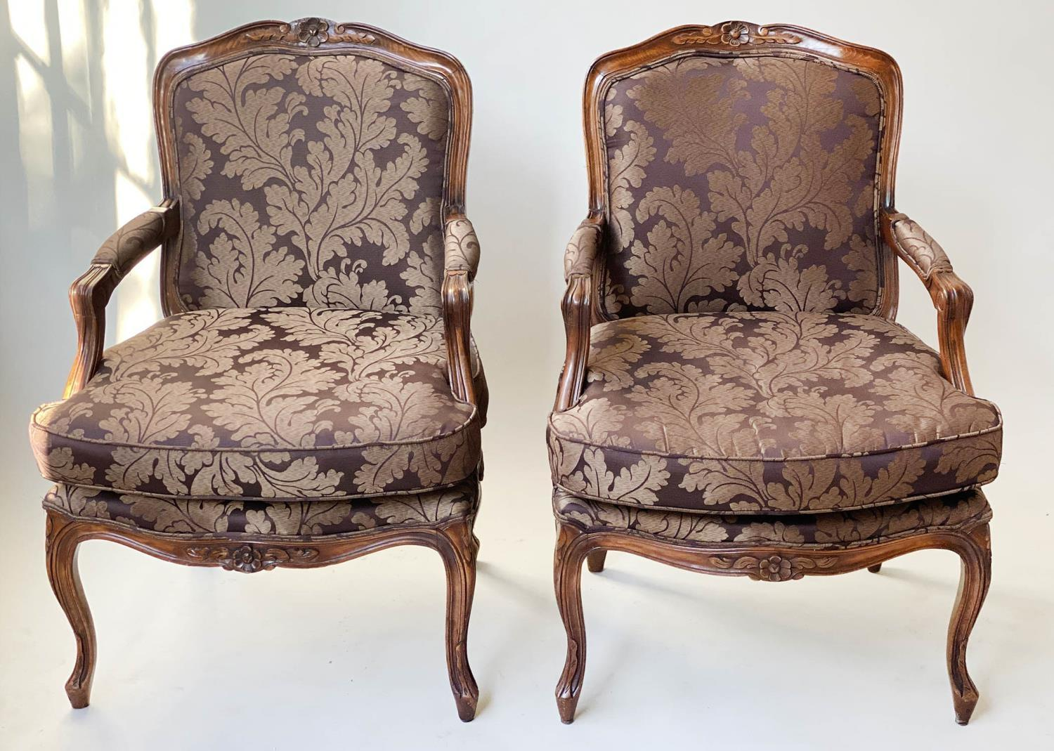 FAUTEUILS, a pair, French Louis XV style, stained walnut, with two tone brown leaf silk