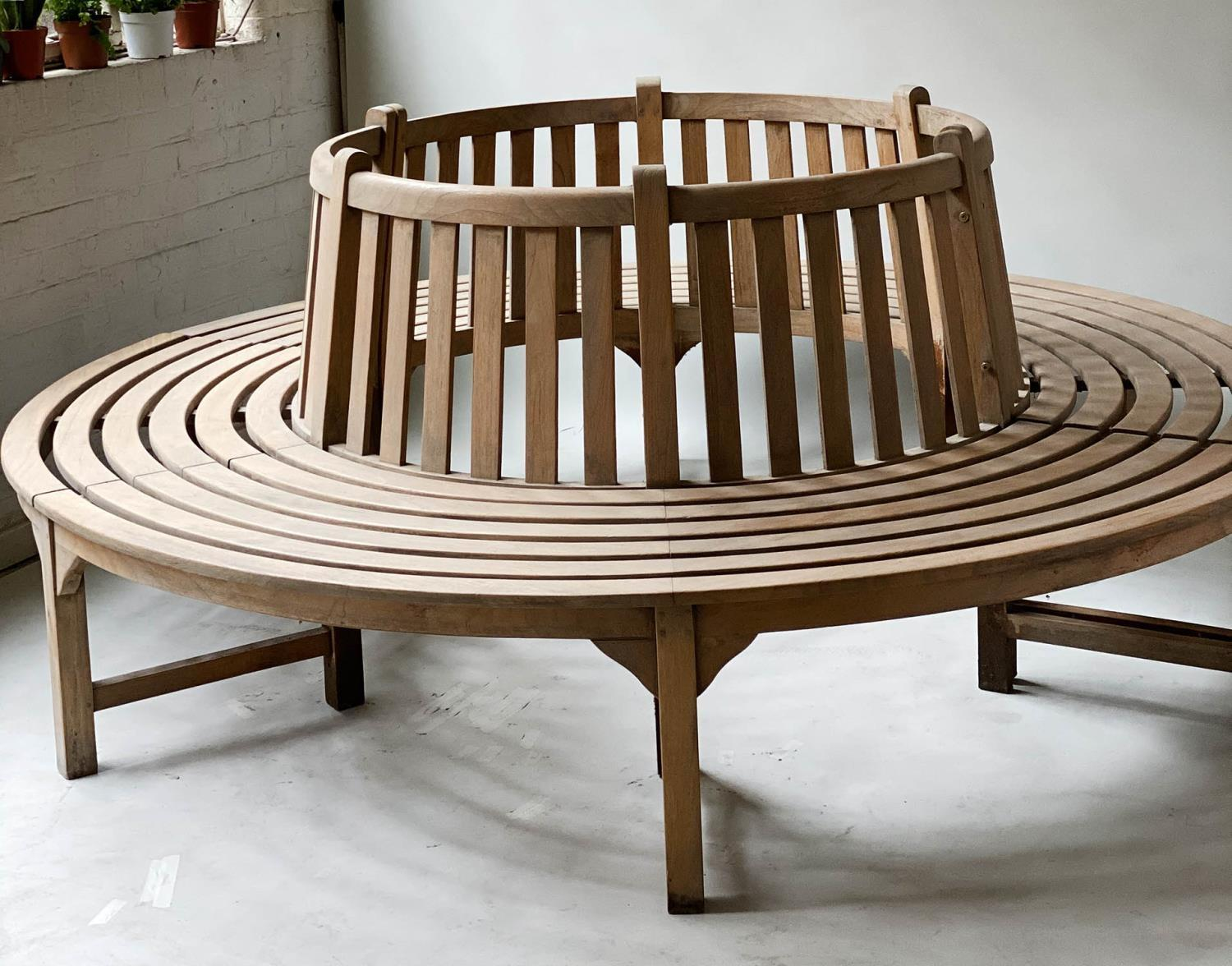 TREE BENCH, weathered teak and slatted in two sections of concentric slats and raised back rest, - Image 5 of 7
