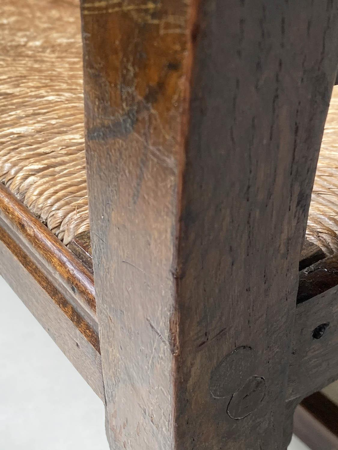 HALL BENCH, 19th century English oak with spindle back rush seat and stretchered turned supports, - Image 7 of 9