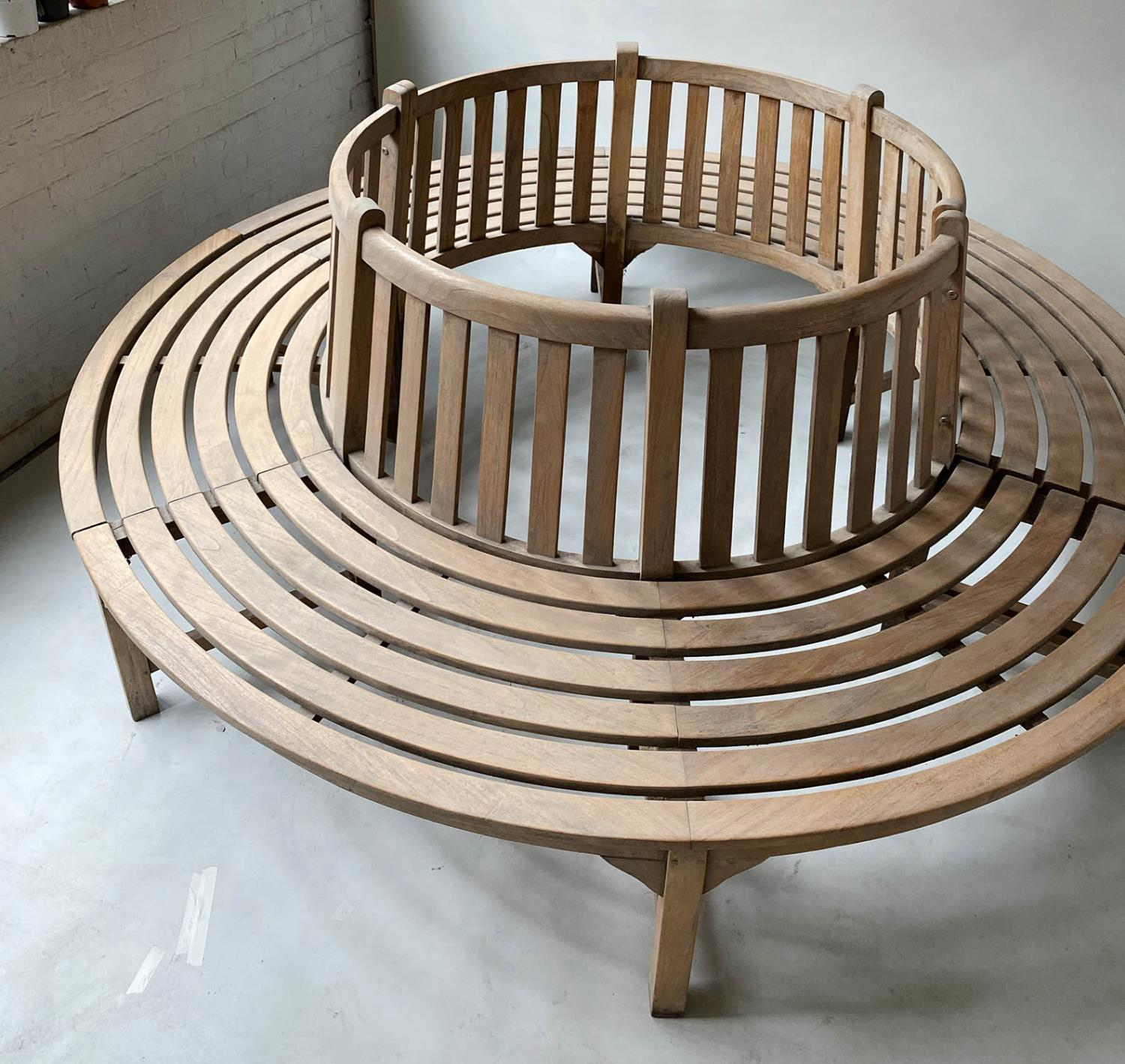 TREE BENCH, weathered teak and slatted in two sections of concentric slats and raised back rest, - Image 2 of 7