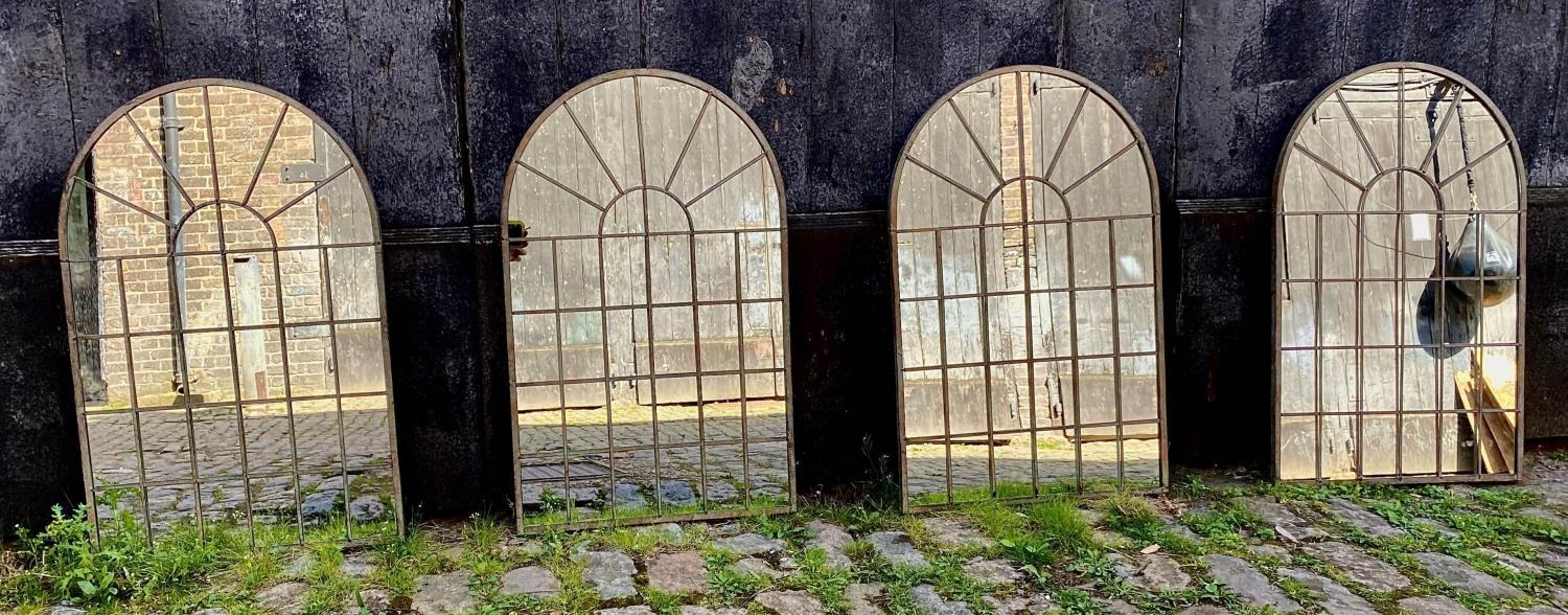ARCHITECTURAL GARDEN WALL MIRRORS, a set of four, aged metal frames, 77cm H x 49cm W. (4)