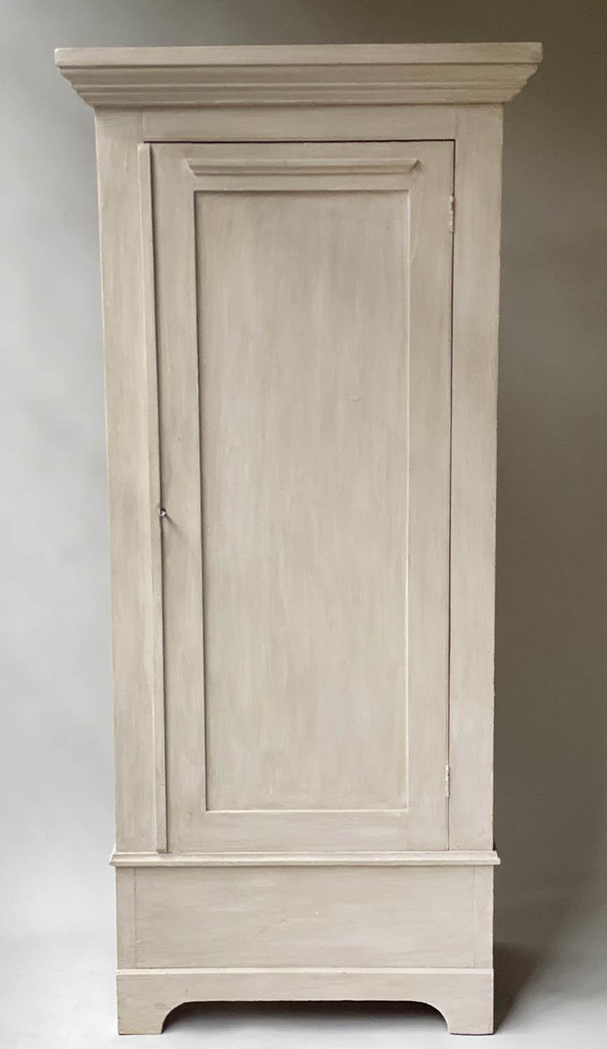 ARMOIRE, 19th century, traditionally grey painted with panelled door enclosing hanging space,
