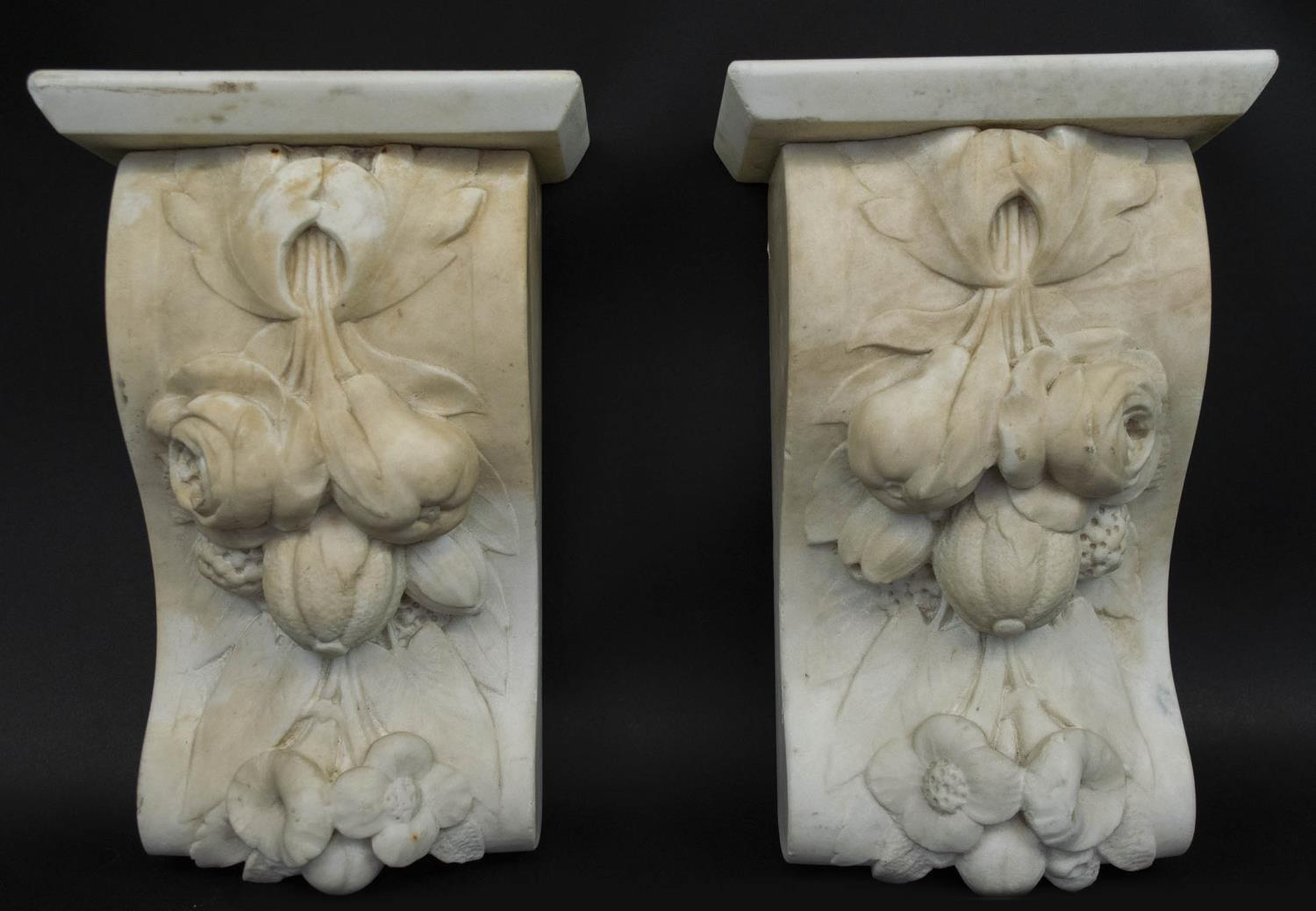 CORBELS, a pair, Victorian carved marble, of flowers and fruit, 30cm H x 18cm W. (2)
