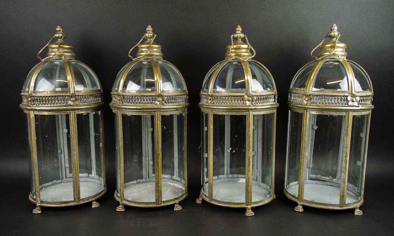 STORM LANTERNS, a set of four, Regency style, gilt metal finish, 55cm H. (4)
