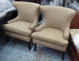 ARMCHAIRS, a pair, with neutral upholstery, 84cm W x 101cm H. (2)