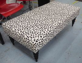 FOOTSTOOL, in black and white leopard spot fabric, 41cm H x 65cm x 127cm L.