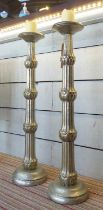PRICKET CANDLE STICKS, a pair, metal repousse finish, 92cm H. (2)
