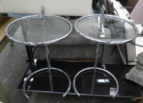 AFTER EILEEN GRAY E1027 STYLE SIDE TABLES, a set of three, 77cm H x 51cm diam at tallest. (3)