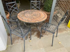 GARDEN TABLE AND CHAIRS, circular mosaic brick top on a cast iron base, 73cm H x 90cm x 90cm, with