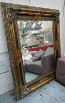 WALL MIRROR, gilt and silvered and faux tortoiseshell finish, bevelled glass, 142cm x 173cm.