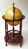 GLOBE COCKTAIL CABINET, in the form of an antique terrestrial globe on stand with rising lid and
