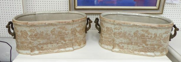 CHINESE STYLE JARDINIERES, a pair, twin handled ceramic decorated, 55cm W x 21cm H. (2)