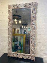 WALL MIRROR, carved lotus flower design limed frame, 150cm x 80cm.
