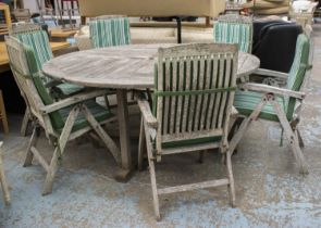 GARDEN TABLE, circular weathered teak 77cm H x 179cm and a set of six weathered teak adjustable