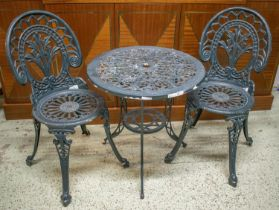 GARDEN SET, distressed painted metal table with circular top 63cm H x 61cm and a pair of chairs. (3)