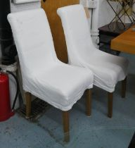 OKA DINING CHAIRS, six, 43cm W x 100cm H with removable cream covers. (6)