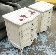 BEDSIDE CHESTS, a pair, serpentine fronted, distressed cream painted, each with four drawers, 52cm W