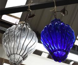 CEILING LIGHTS, two, one clear and another blue tinted glass, 104cm drop at largest. (2)