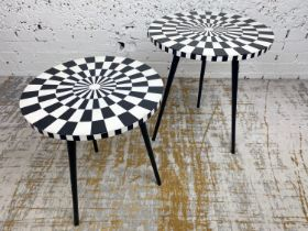 SIDE TABLES, a graduated pair, 1970's Italian design, circular inlaid tops on tripod metal legs,