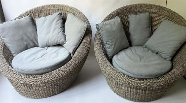 EASY ARMCHAIRS, 122cm W, a pair, grey rattan, of rounded design, each with grey seat and scatter