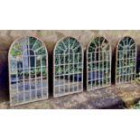 ARCHITECTURAL GARDEN MIRRORS, four, 60cm x 36cm, aged metal frames. (4)