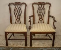 DINING CHAIRS, a set of twelve, Chippendale style, including two armchairs with cream damask