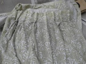 CURTAINS, a pair, each 161cm gathered by 299 drop, lined and interlined green patterned fabric. (2)
