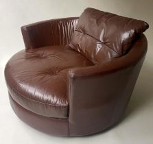EASY REVOLVING ARMCHAIR, oversized grained tan leather, 132cm W.